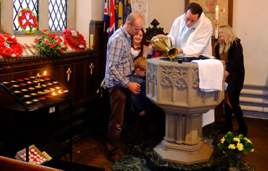 Photo of the baptismal font being filled at St Paul's Church Winlaton