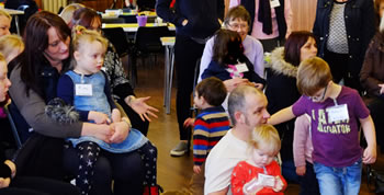 Photo of families enjoying activities in the church hall at St Paul's